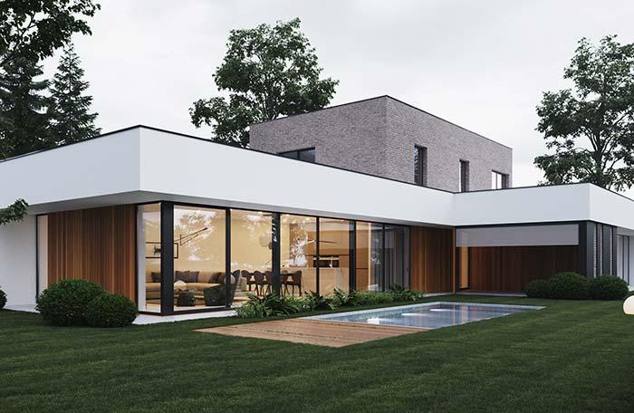 Casa térrea luxuosa com telhado embutido.
