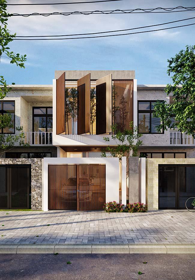 Casa em sobrado com pequena e moderno com telhado embutido.