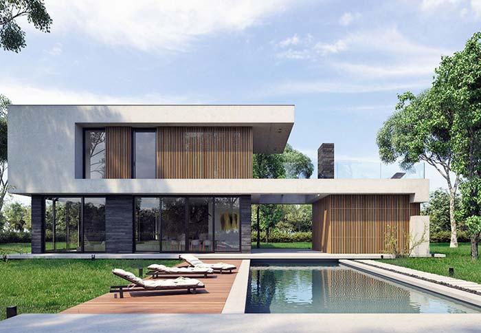 Casa moderna com piscina e telhado embutido.