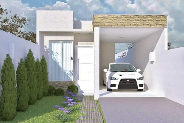 Fachada de casa pequena com uma garagem.