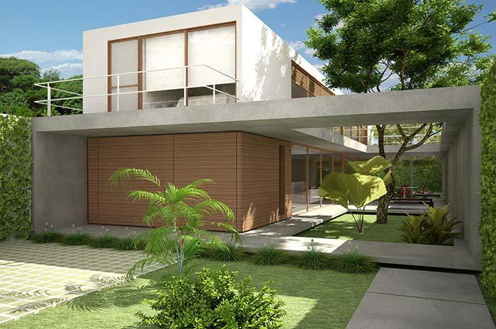 Fachada de casa moderna com jardim.