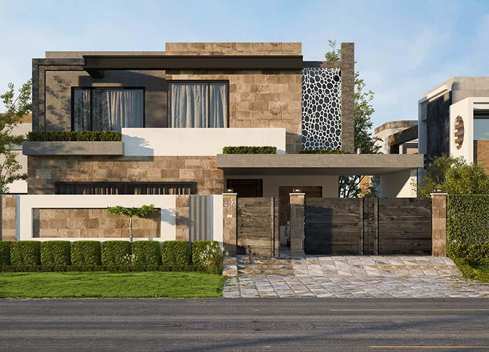 Fachada de casa com revestimento de pedra.