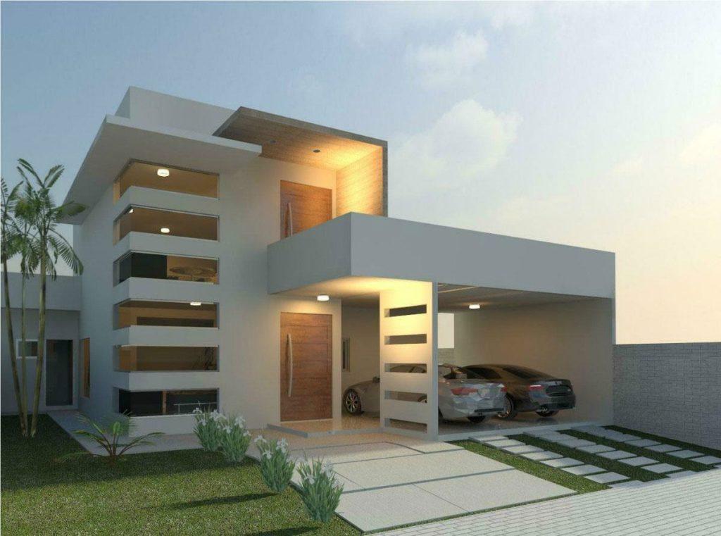 Fachada de sobrado com varanda e projeto moderno.