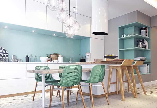 Cozinha com ilha moderna com mesa de madeira.