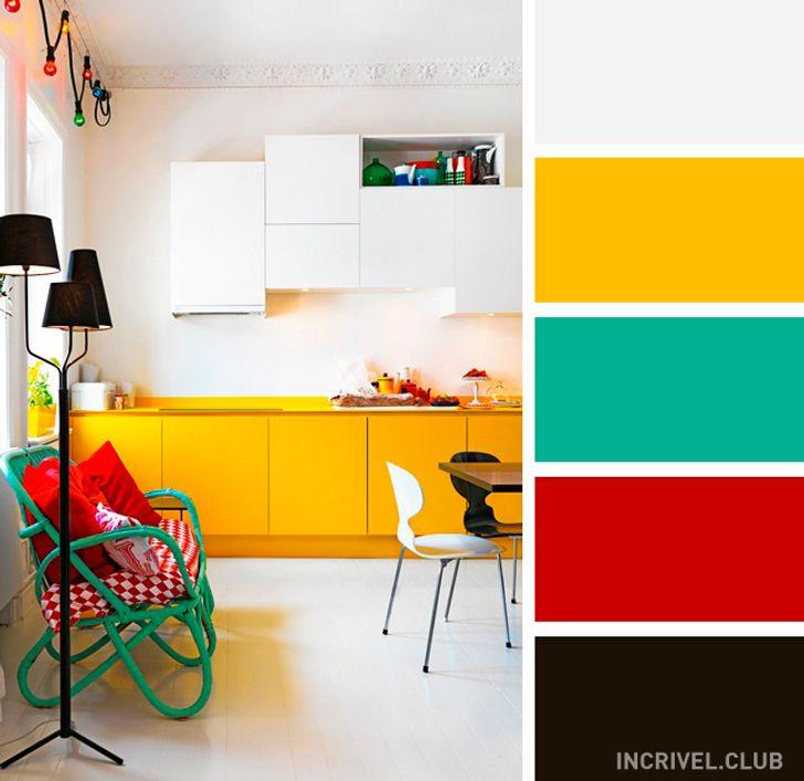Cozinha moderna com armário amarelo.