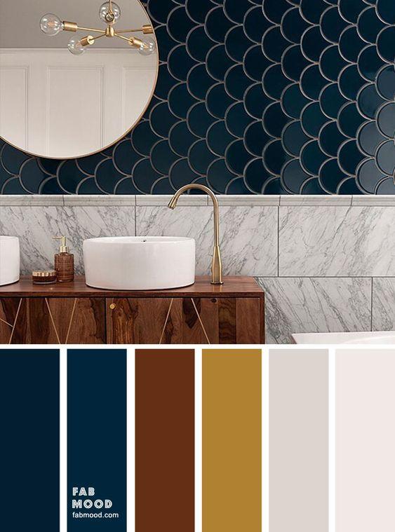 Banheiro moderno com revestimento de mármore e espelho redondo.