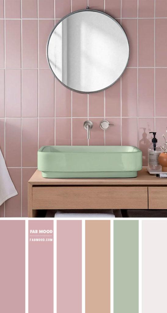 Banheiro com revestimento rosa e cuba verde.