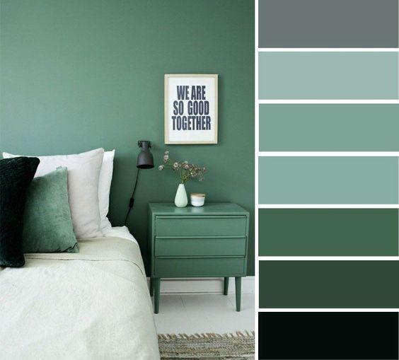 Quarto com decoração verde.