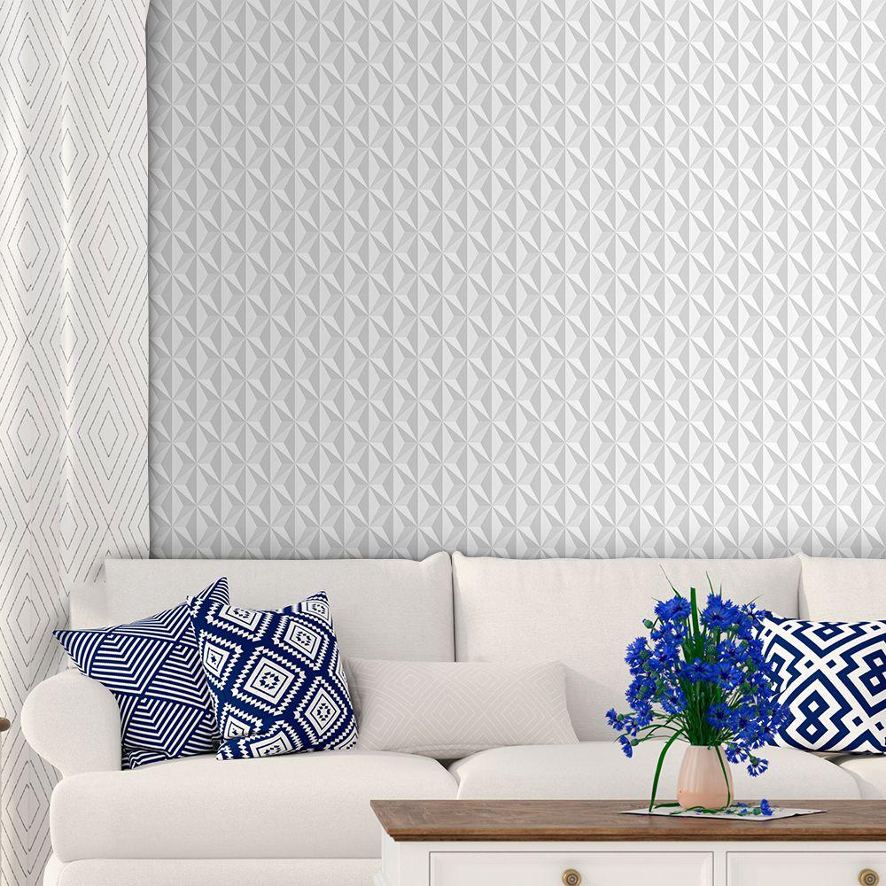 Papel de parede 3D para sala clean e sofá branco.