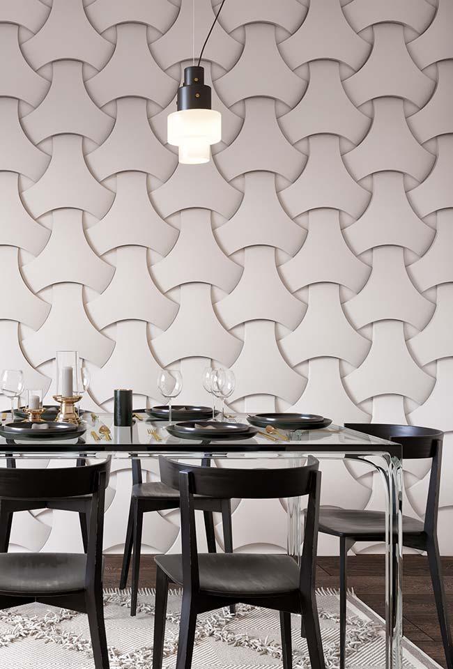 Sala de jantar com mesa de vidro moderno.