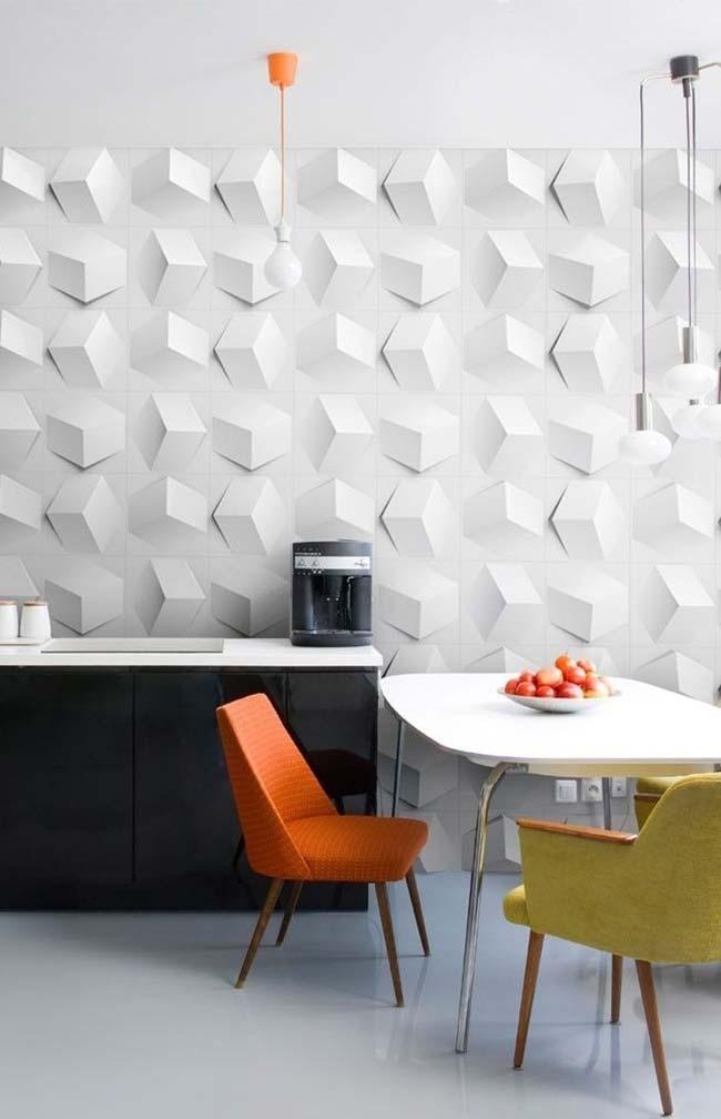Cozinha moderna com armários pretos.