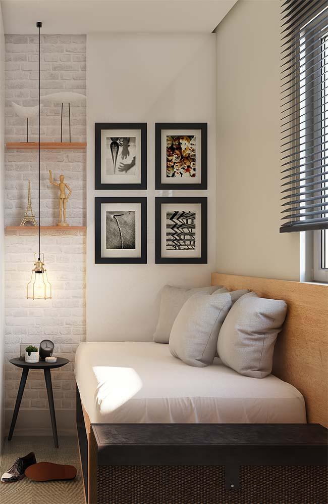 Quarto de solteiro moderno com parede de tijolinho branco.