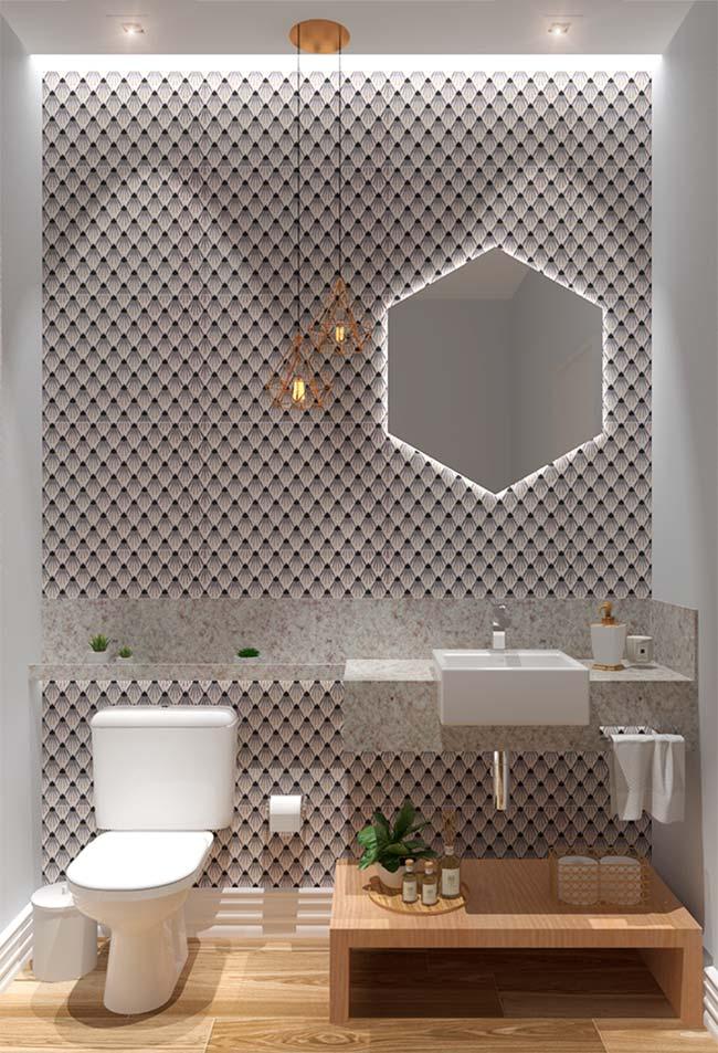 Banheiro moderno pequeno com bancada de granito.