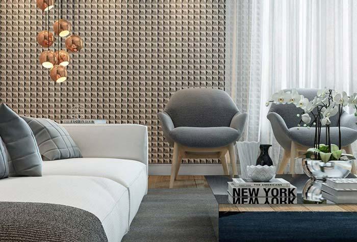 Sala moderna com decoração branca e cinza.