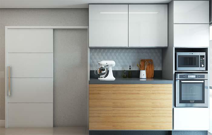 Cozinha com armário de linhas modernas.