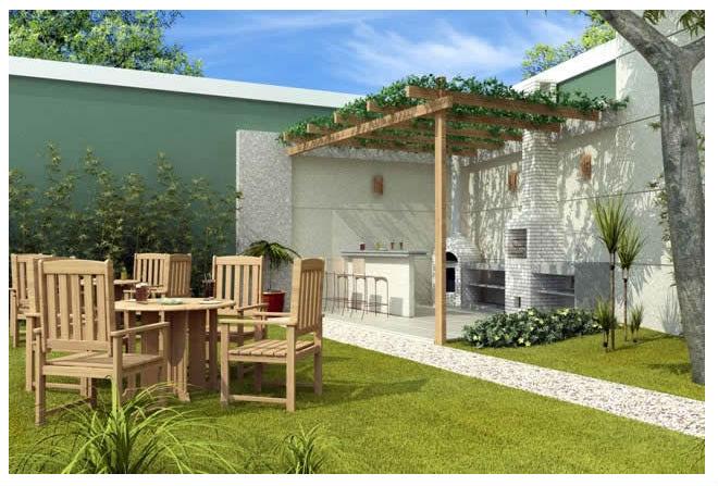 Área de churrasqueira de tijolinho branco e jardim.