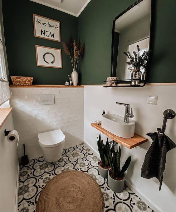 Lavabo branco e verde.