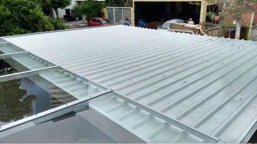 telha sanduiche e telhado de vidro