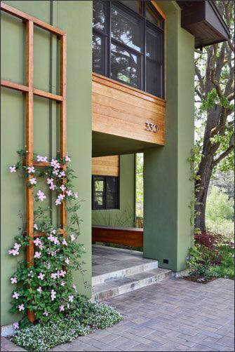 fachada verde e madeira