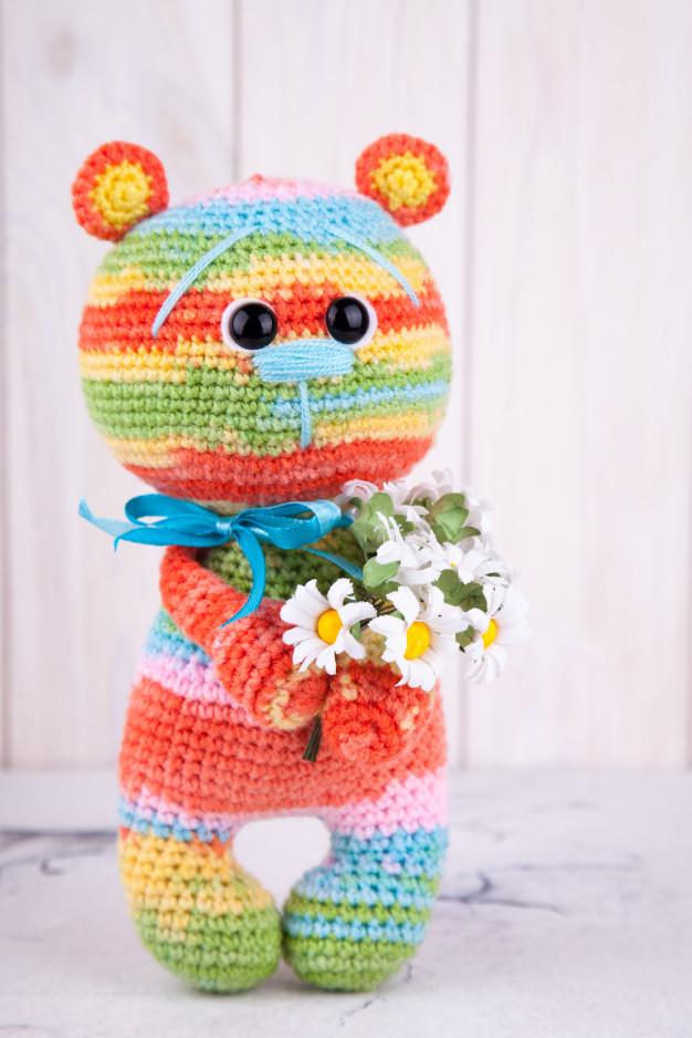 urso colorido com flores