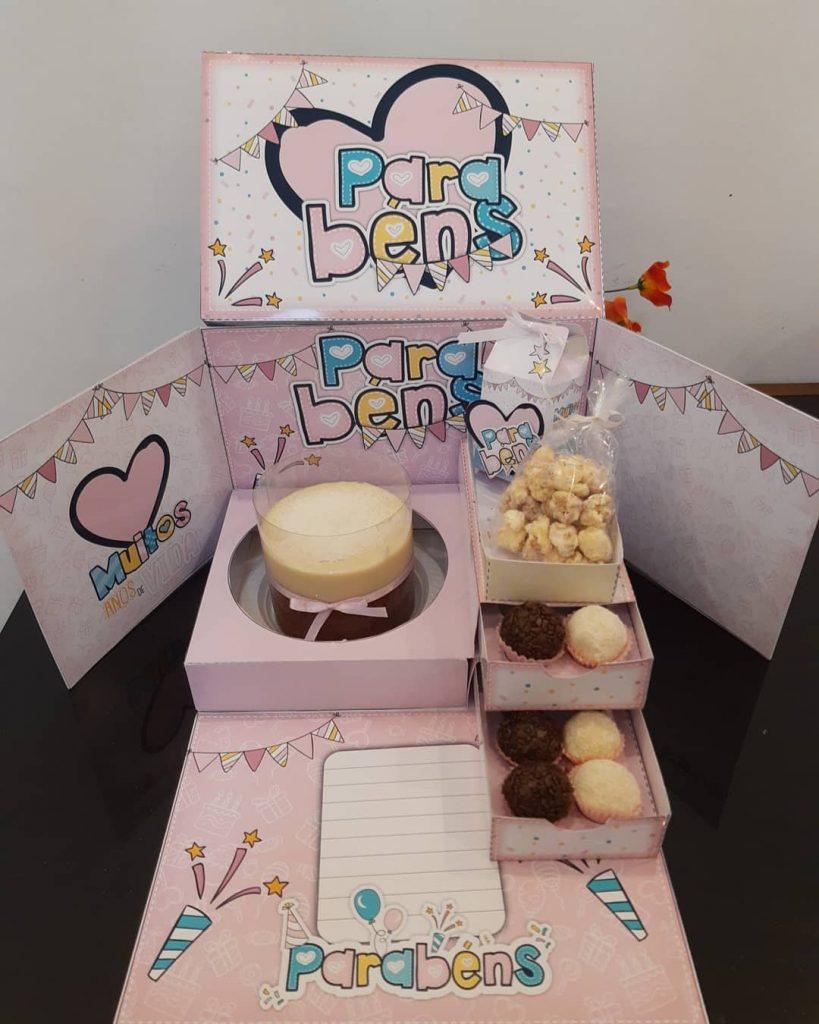 Festa na caixa com bolo vulcão