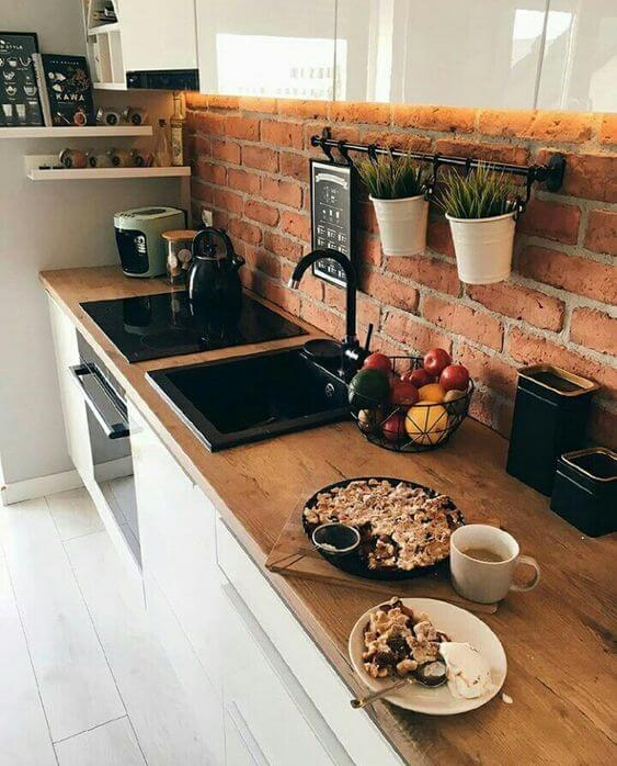 cozinha com parede rústica