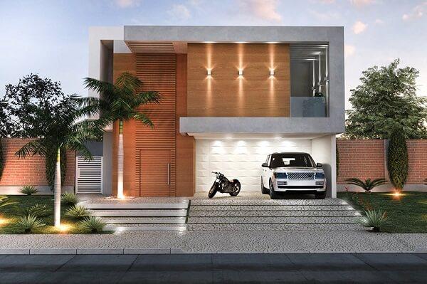 casa moderna com madeira e platibanda